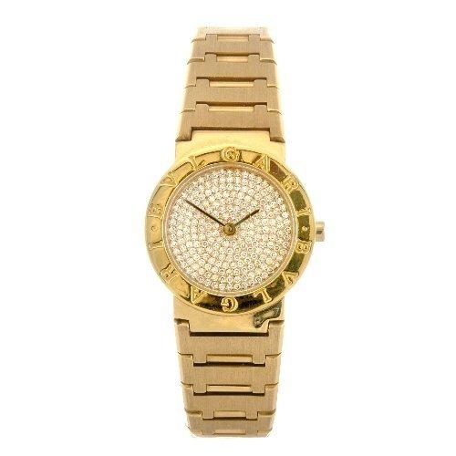 7: (75808) An 18k gold quartz lady's Bulgari bracelet w