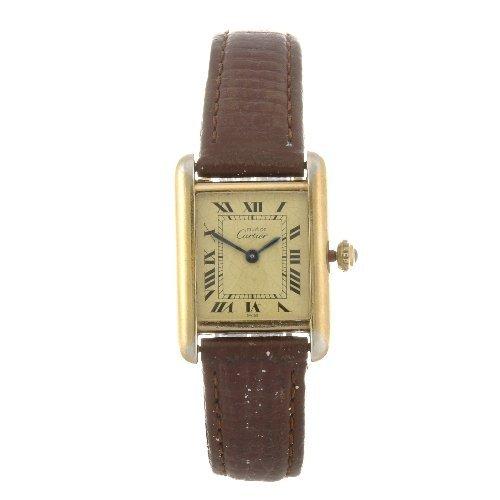 9: A gold plated quartz lady's Must de Cartier Tank Ver
