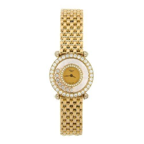 11: (75808) An 18ct gold quartz lady's Chopard Happy Di