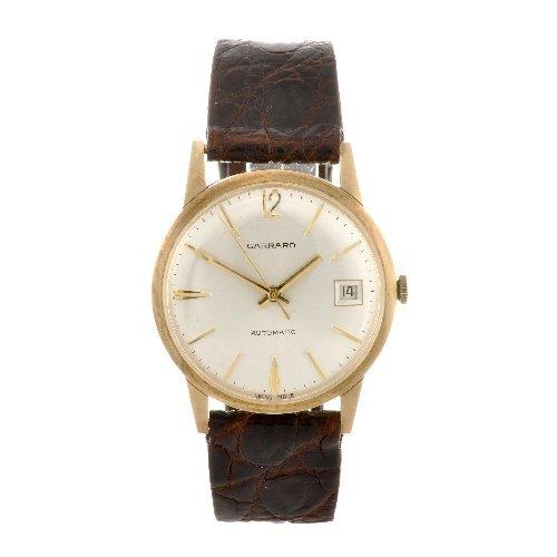 15: A 9ct gold automatic gentleman's Garrard wrist watc