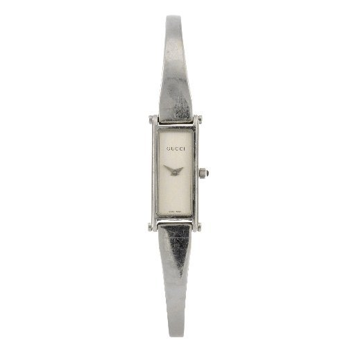 19: A stainless steel quartz lady's Gucci 1500L bangle