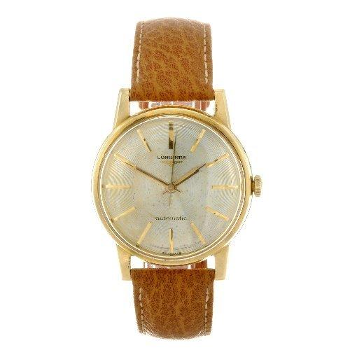 30: An 18k gold automatic gentleman's Longines wrist wa