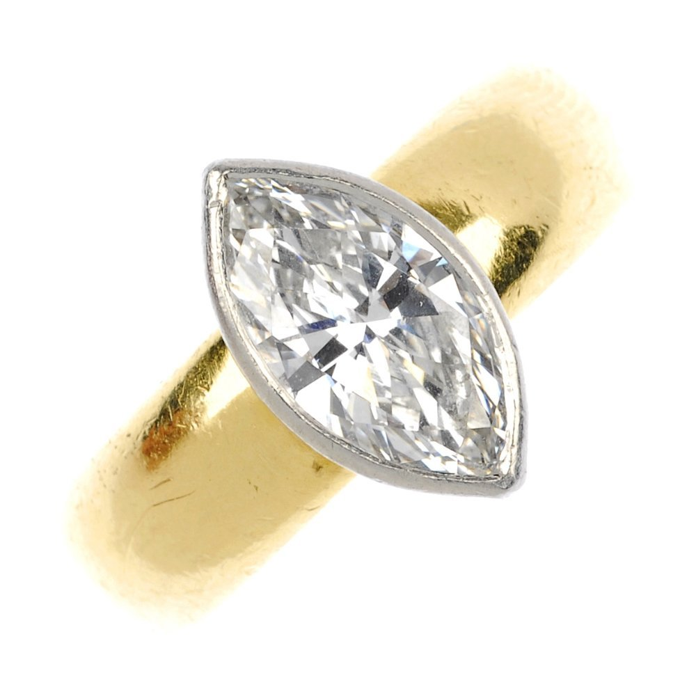 23: (118612-1-A) An 18ct gold marquise single-stone dia