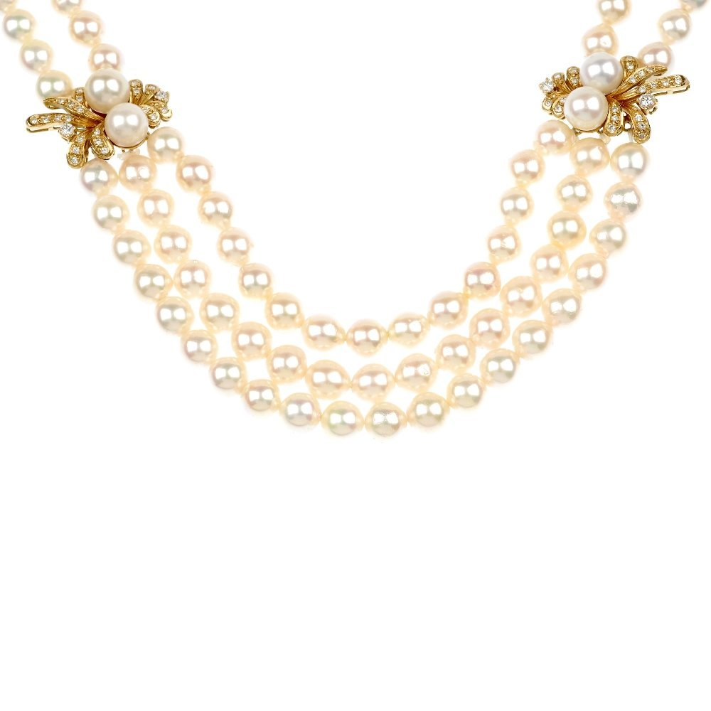 24: (118612-2-A)  A suite of cultured pearl and diamond