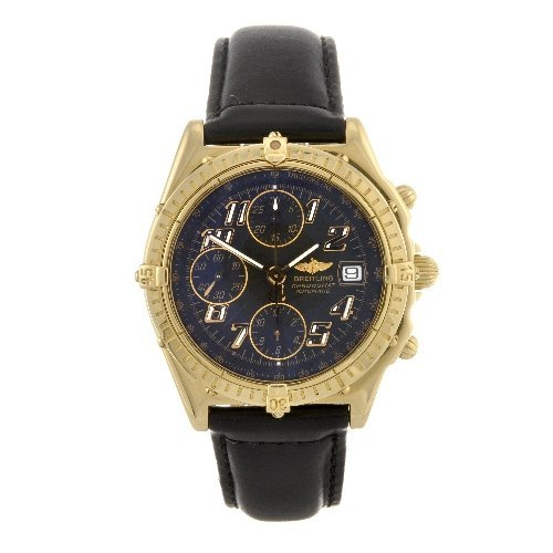 12: An 18k gold automatic gentleman's Breitling Windrid