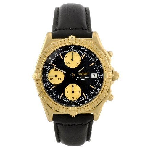 13: An 18k gold automatic gentleman's Breitling Windrid