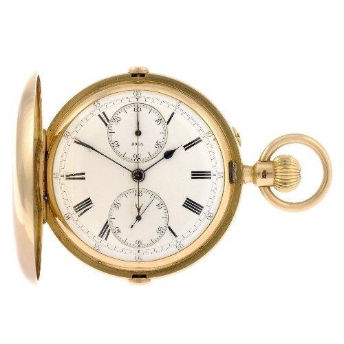 9: An 18k gold keyless wind full hunter pocket watch.