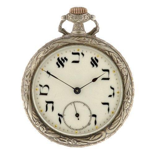 109: A base metal keyless wind open face Judaic pocket