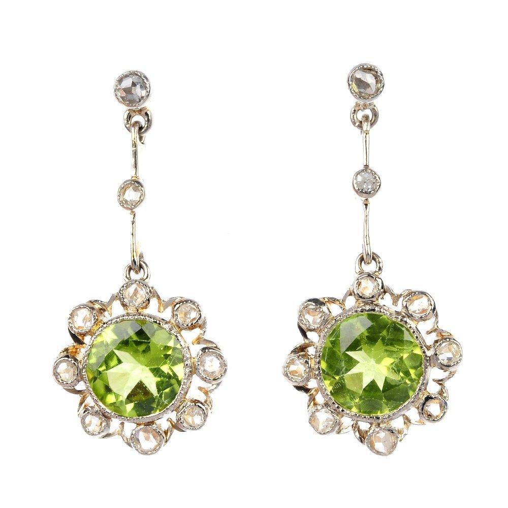 10: A pair of peridot and diamond ear pendants.