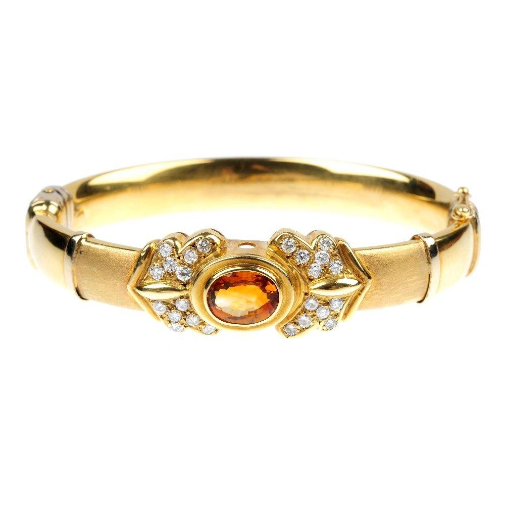 15: A citrine and diamond hinged bangle.