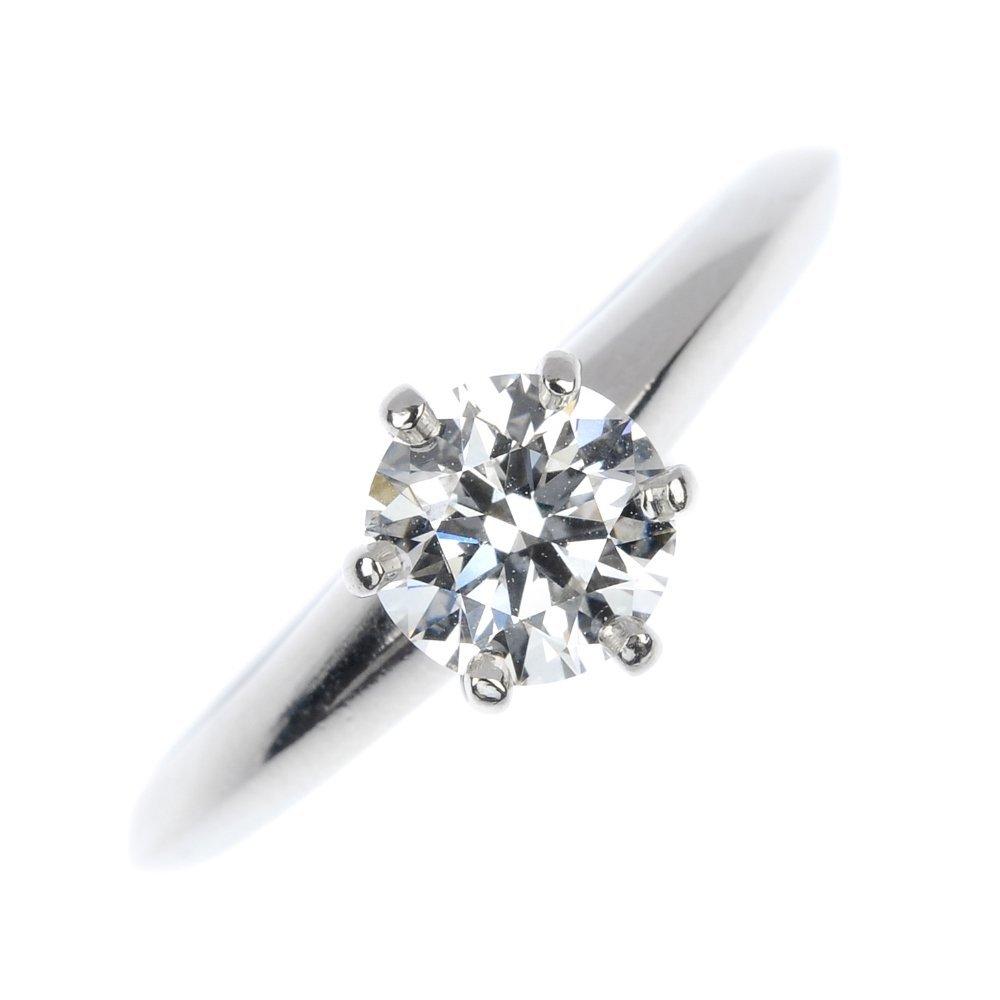 328: TIFFANY & CO.- a diamond single-stone ring.