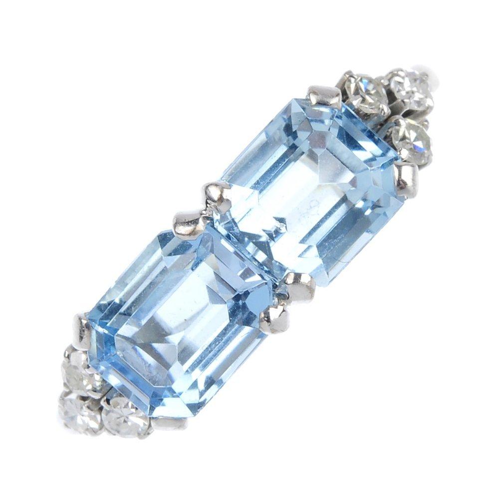 1: An aquamarine and diamond dress ring.
