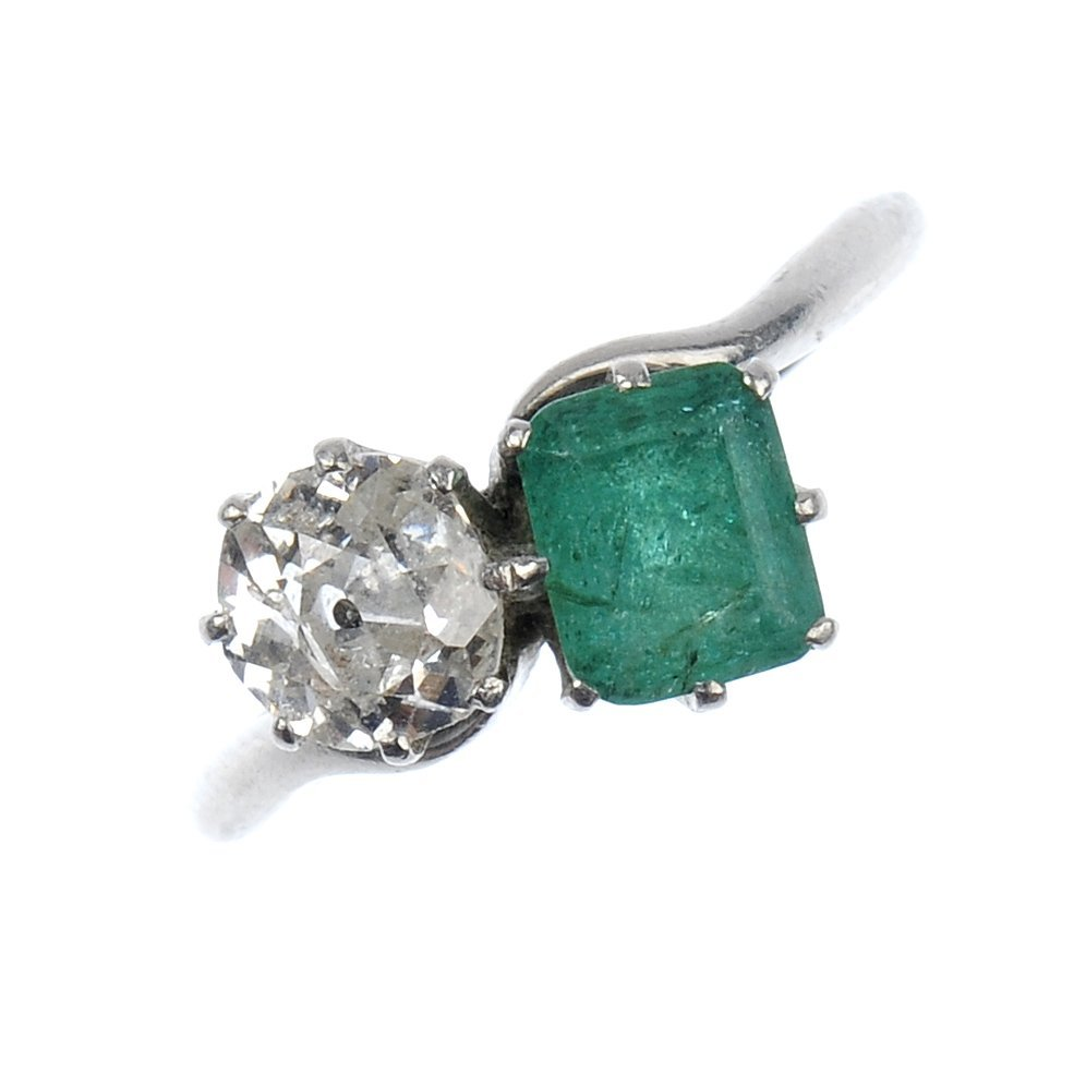 5: A diamond and emerald two-stone crossover ring.