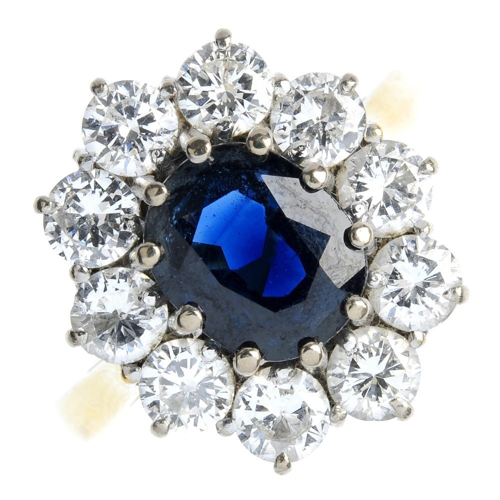 7: An 18ct gold sapphire and diamond cluster ring.