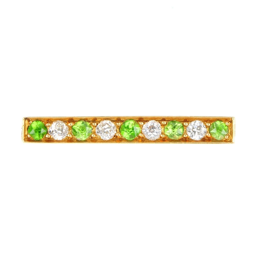 9: An early 20th century 18ct gold demantoid garnet and