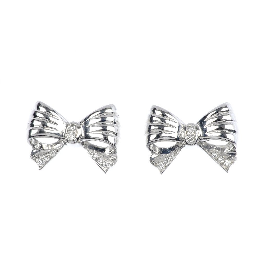10: A pair of 18ct gold diamond bow ear studs.