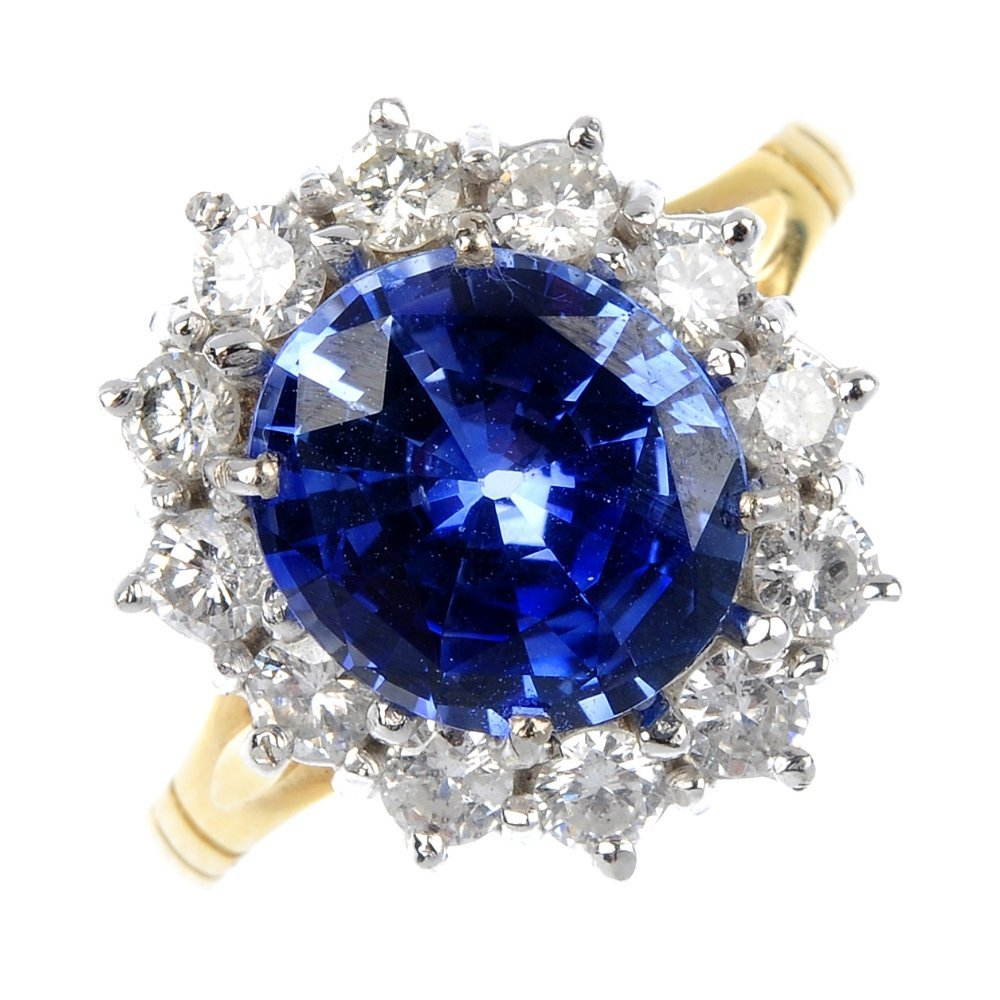 15: An 18ct gold sapphire and diamond cluster ring.