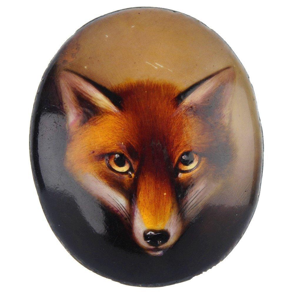 18: A late 19th century enamel on copper fox head plaqu