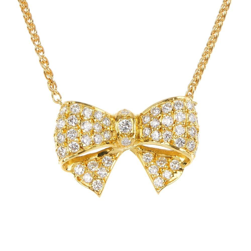 20: An 18ct gold diamond bow pendant.