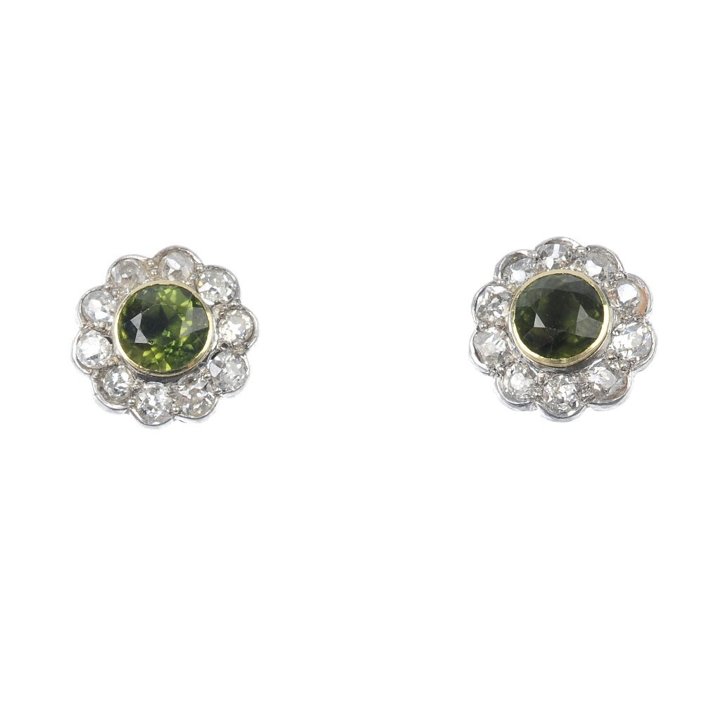 21: A pair of peridot and diamond cluster earrings.