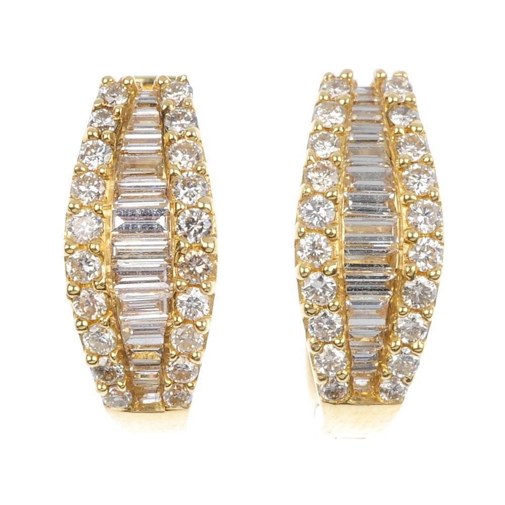 22: A pair of diamond earrings.