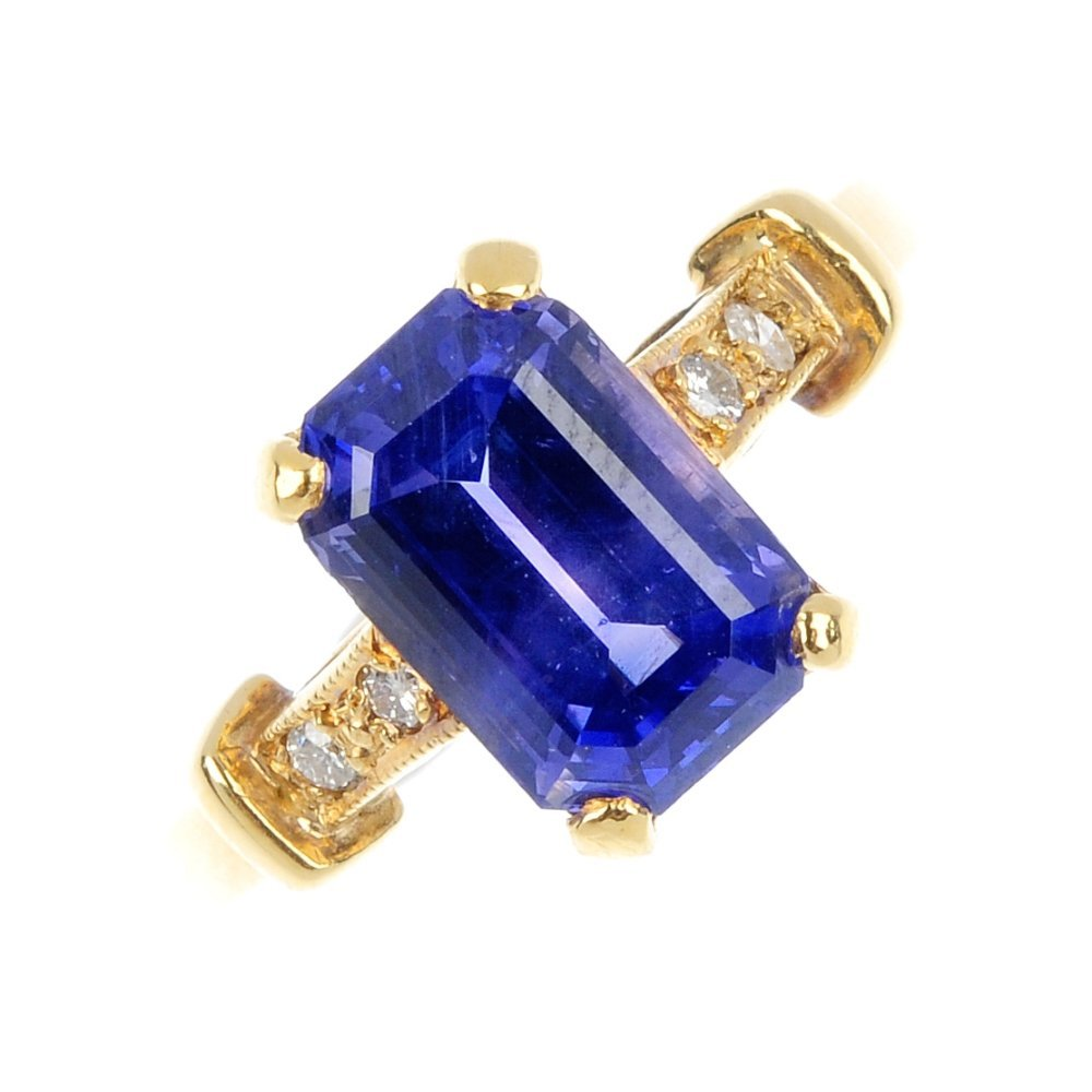 23: A sapphire and diamond ring.