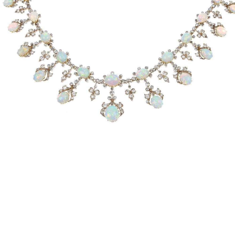 151: A late 19th century silver and gold opal and diamo