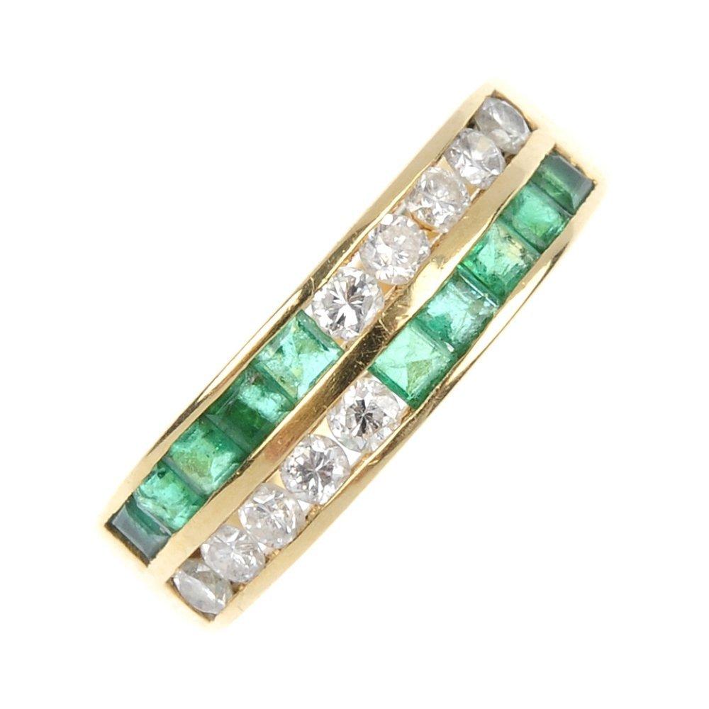 533: An emerald and diamond dress ring.