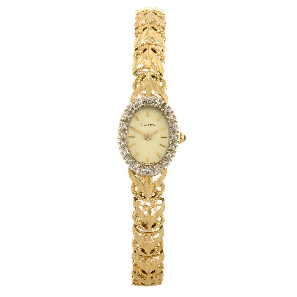 11: A 14k gold quartz lady's Bulova bracelet watch.
