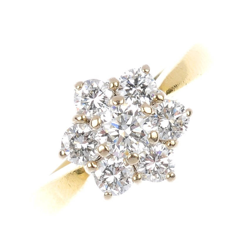 4: An 18ct gold diamond floral cluster ring.