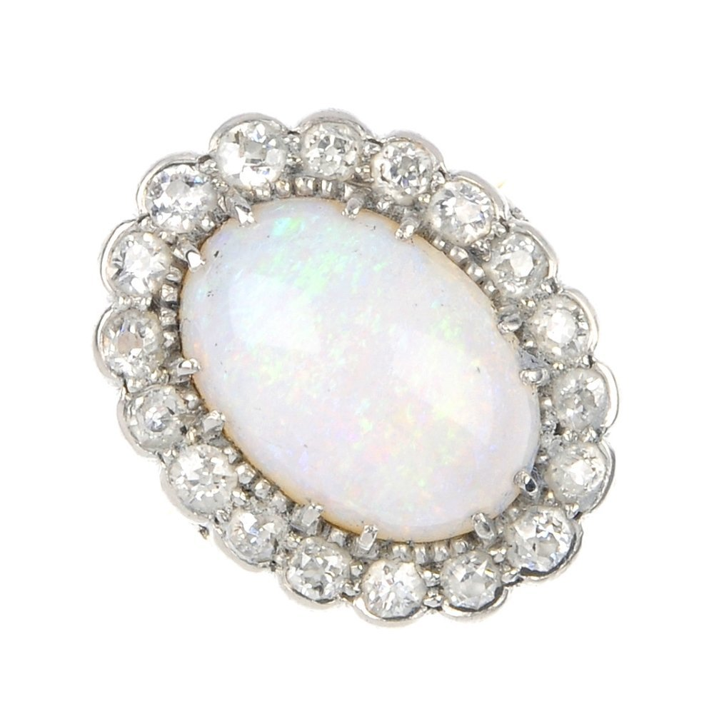 6: A mid 20th century 18ct gold and platinum opal and d