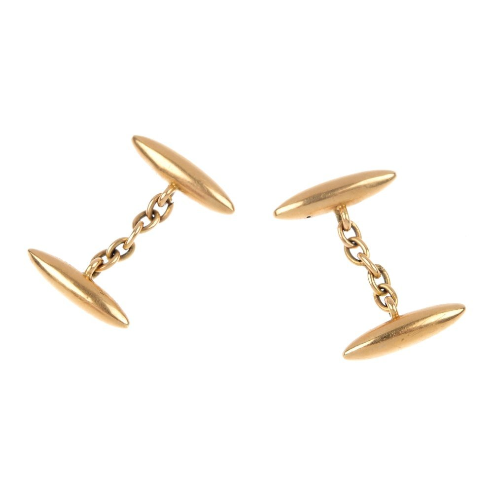 11: A pair of early 20th century 15ct gold cufflinks.