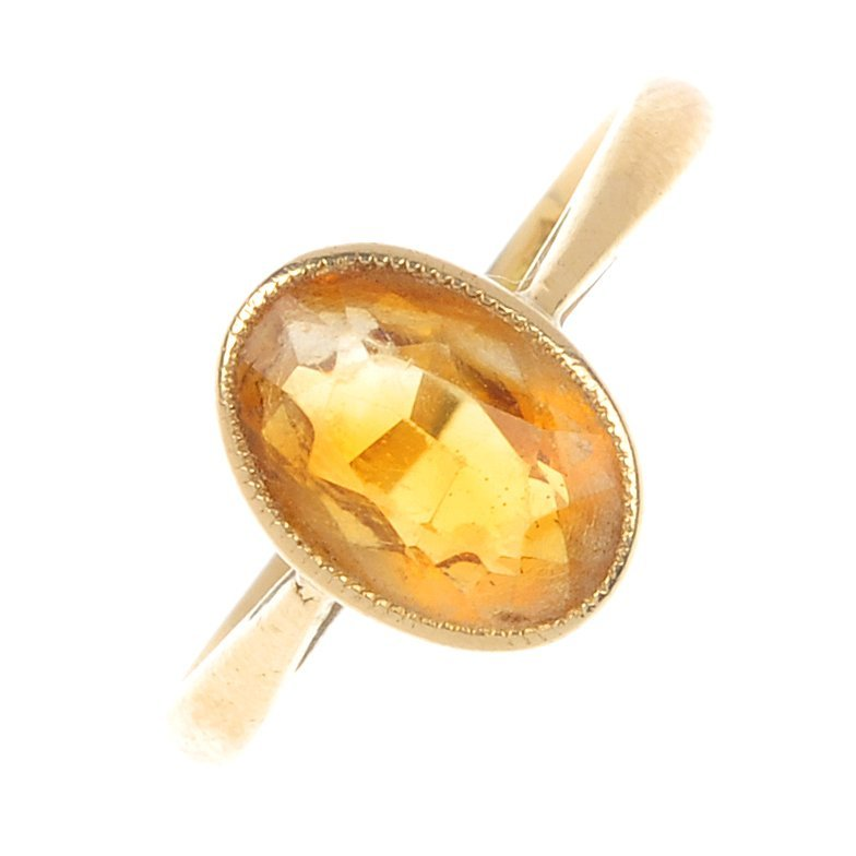 12: An early 20th century 18ct gold citrine single-ston