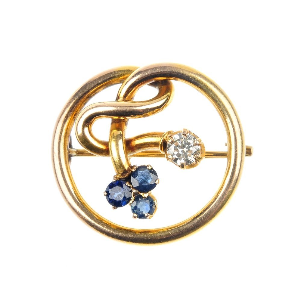 14: A sapphire and diamond brooch.