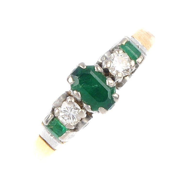 16: An emerald and diamond five-stone ring.
