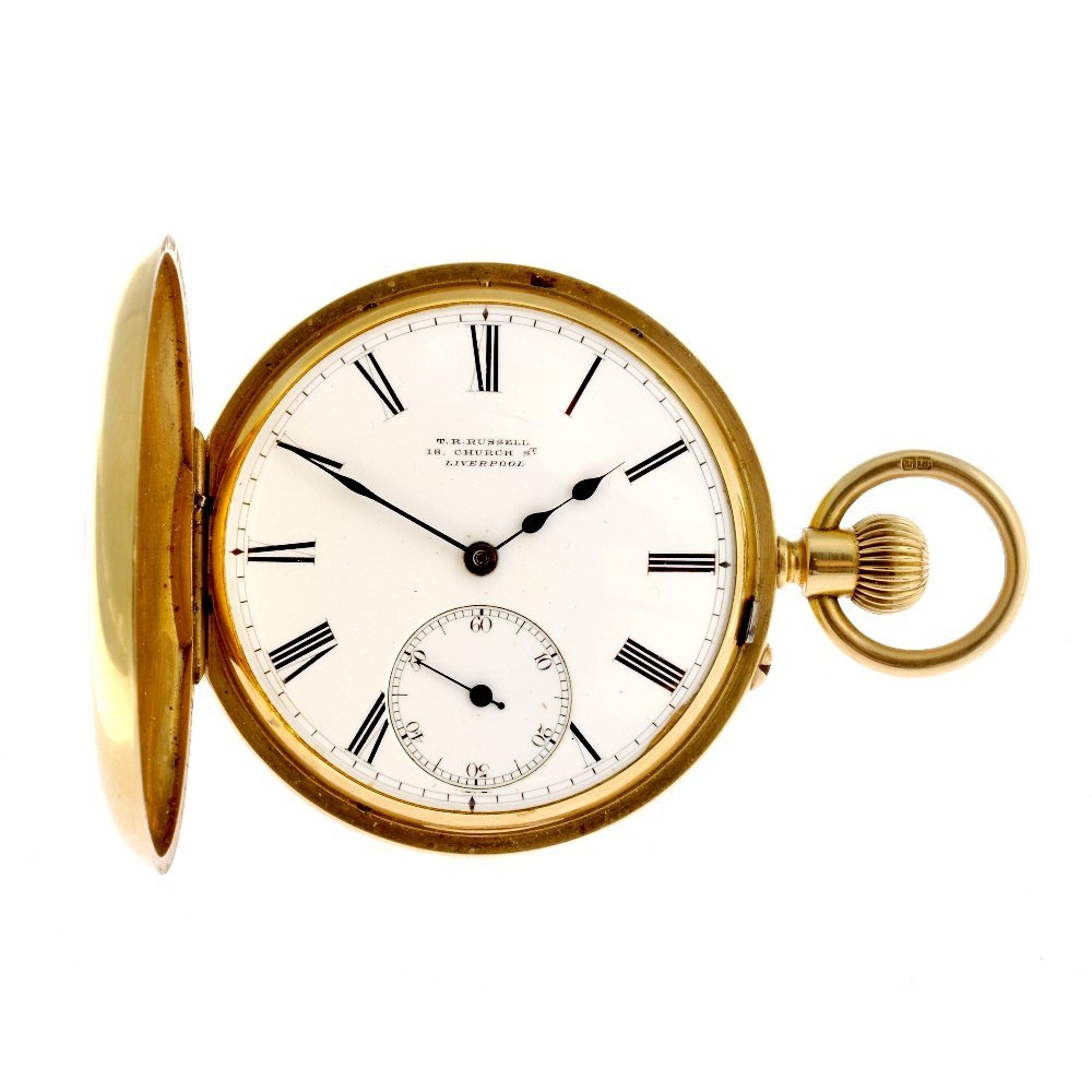 15: An 18ct gold keyless wind half hunter pocket watch