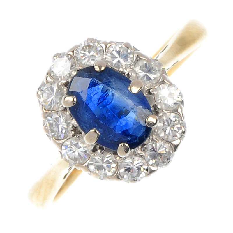 3: An 18ct gold sapphire and diamond cluster ring.