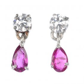 7: A pair of ruby and diamond ear pendants.