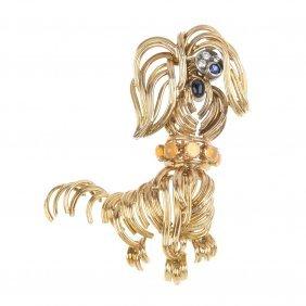 8: A 1970s 18ct gold gem-set dog brooch.