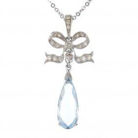 9: An aquamarine and diamond bow pendant.