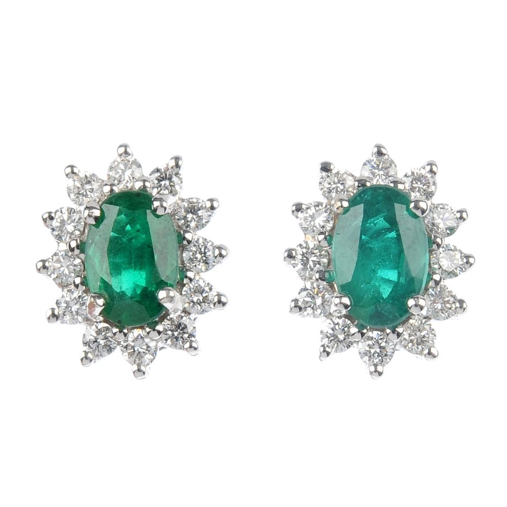 11: A pair of 18ct gold emerald and diamond cluster ear