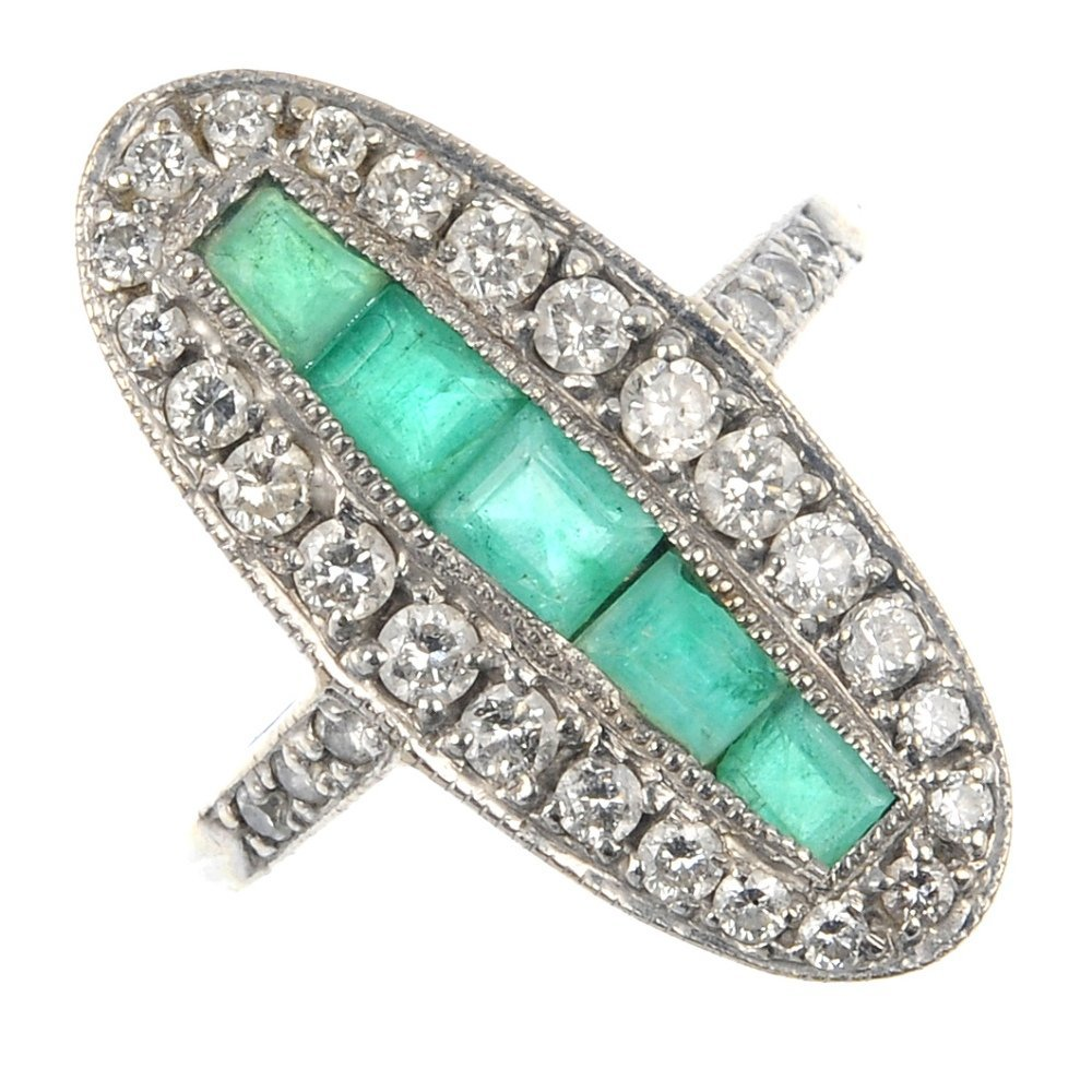 13: An 18ct gold emerald and diamond ring.