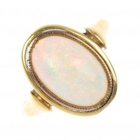 14: An opal single-stone ring.