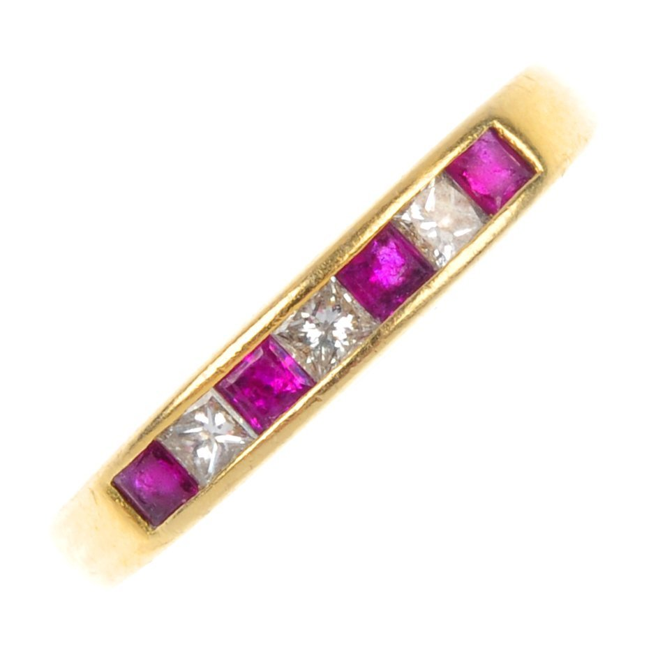 15: An 18ct gold ruby and diamond band ring.