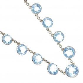 17: An aquamarine necklace.