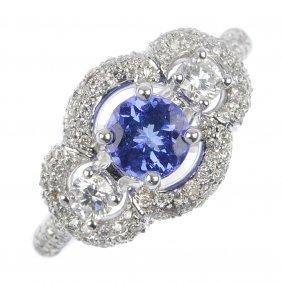 18: An 18ct gold tanzanite and diamond dress ring.