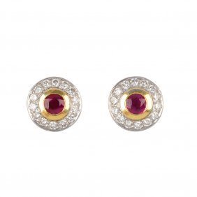 20: A pair of 18ct gold ruby and diamond cluster ear st