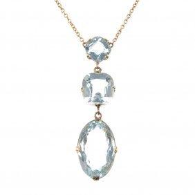 23: An aquamarine pendant.