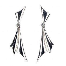 24: A pair of diamond ear pendants.