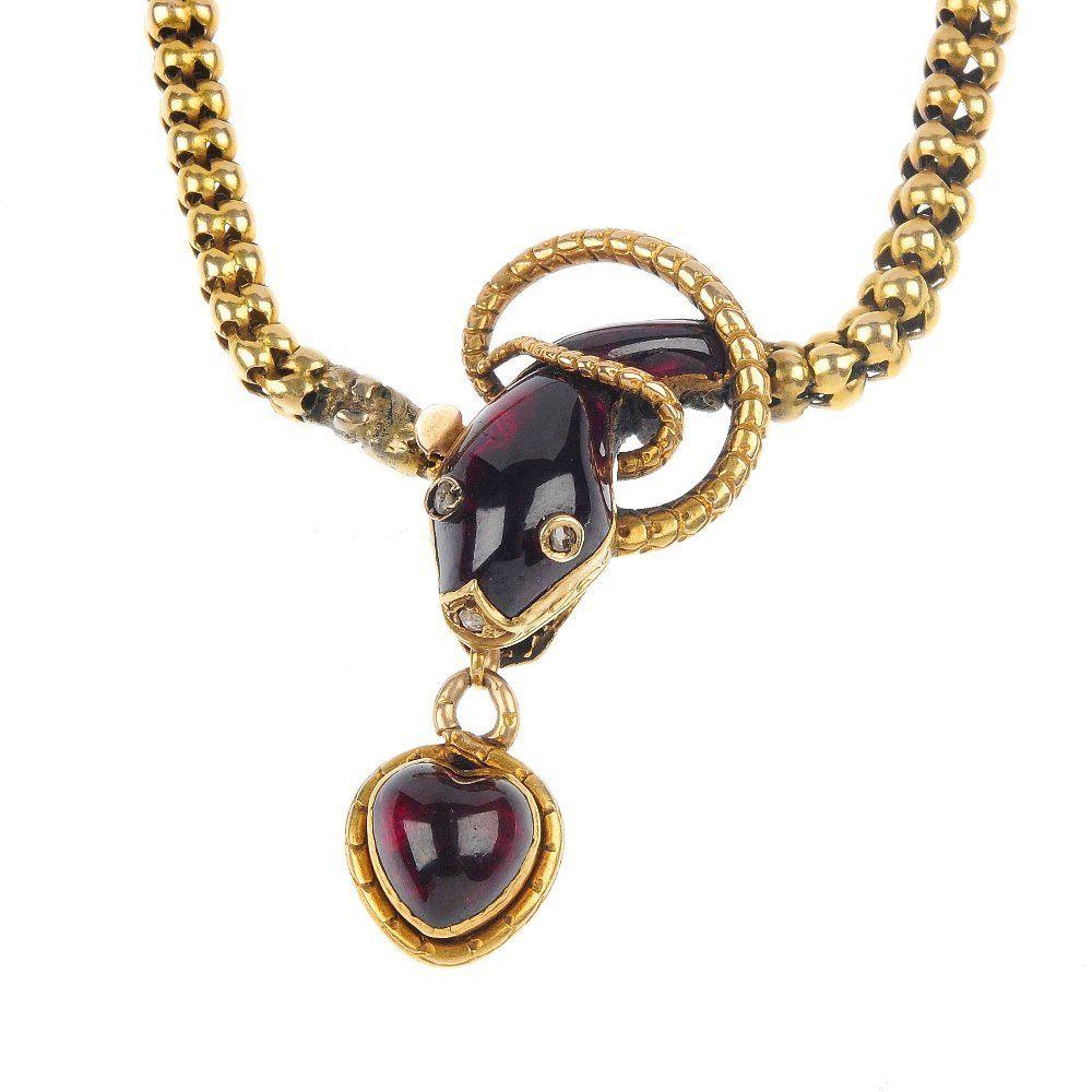 131: A mid 19th century 15ct gold garnet snake necklace